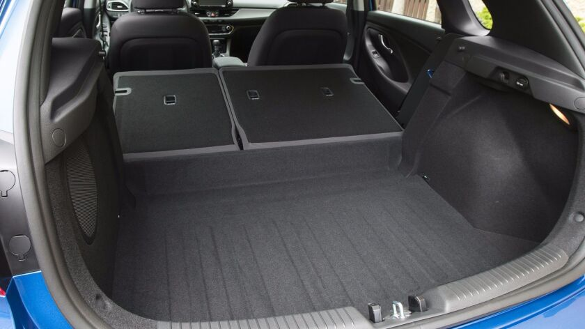 Cargo space is deep with a wide opening (40 inches) and 5 ½ feet of length.