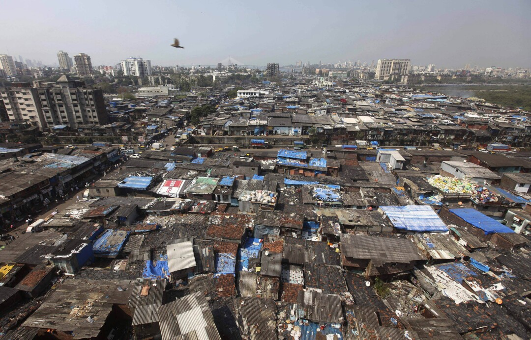 A bird flies over Dharavi, one of Asia's largest slums, in Mumbai, India.