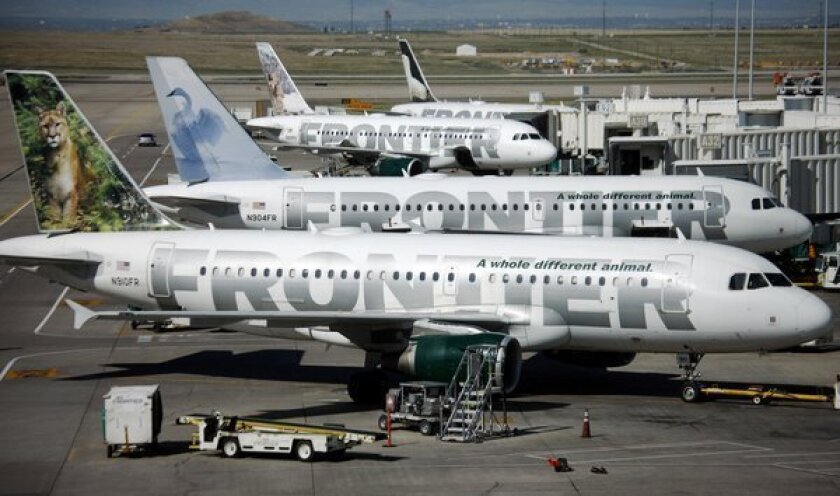 Frontier Airlines will begin charging for carry-on bags this summer.