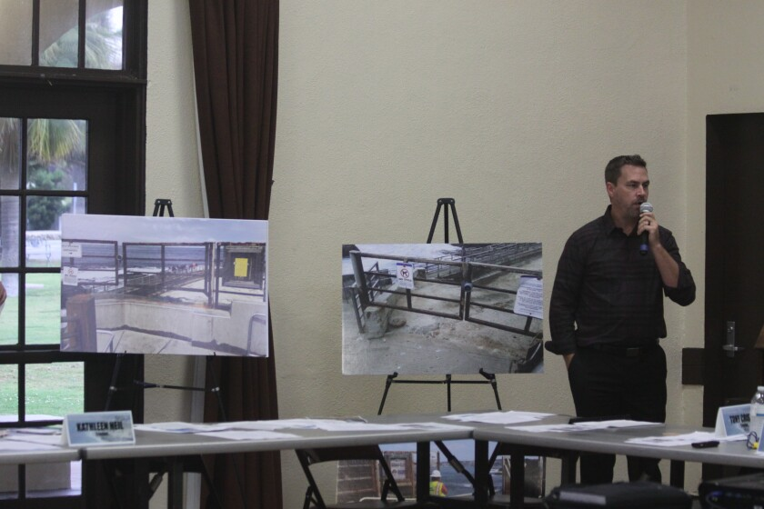 Public Works engineer Jason Grani stands by images of the Children's Pool 'ramp' prior to the City constructing the retaining wall (right) and after (left).