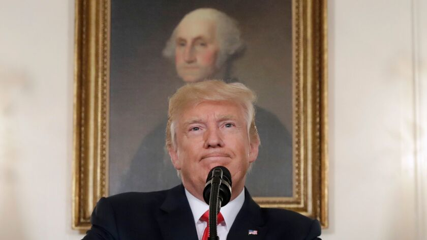 In this Aug. 14, 2017, photo, President Donald Trump pauses while speaking in the Diplomatic Recepti