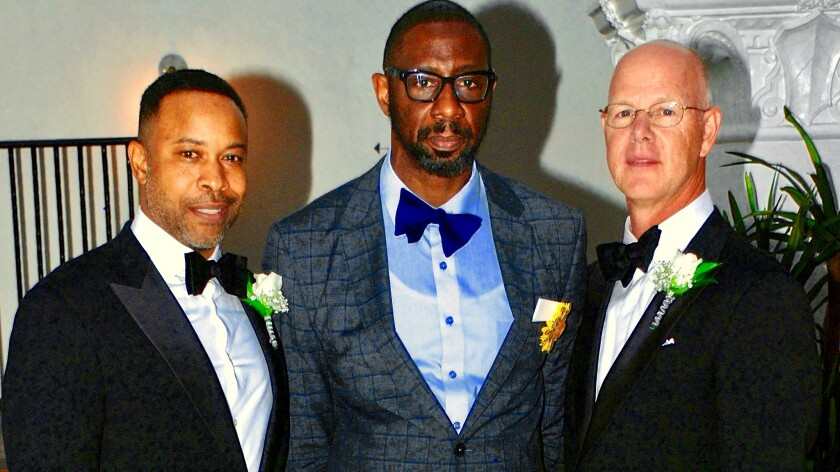 Timothy Dean, center, with friend Mark Chambers, left. Dean died in the West Hollywood apartment of