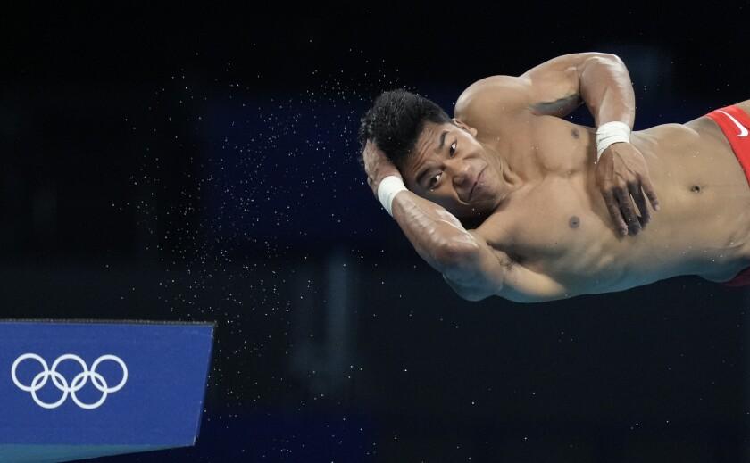 U.S. diver Jordan Windle competes in men's 10-meter platform preliminaries.