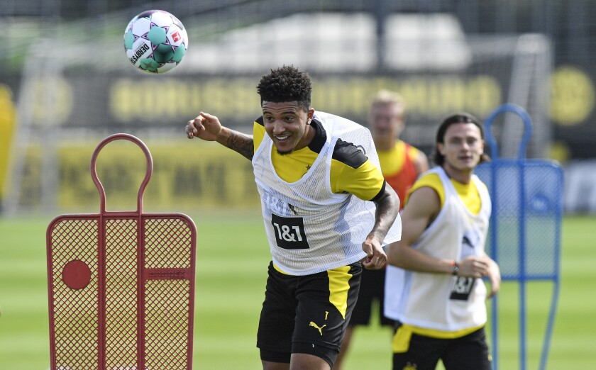 Dortmund's Jadon Sancho heads the ball during the first training session of German Bundesliga club Borussia Dortmund at the training grounds in Dortmund, Germany, Monday, Aug. 3, 2020. (AP Photo/Martin Meissner)