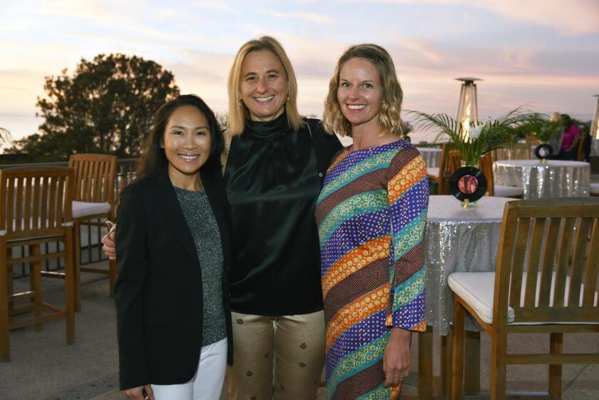 Committee volunteers Pham Zeman, Sonya Solinsky, and Samantha Murray