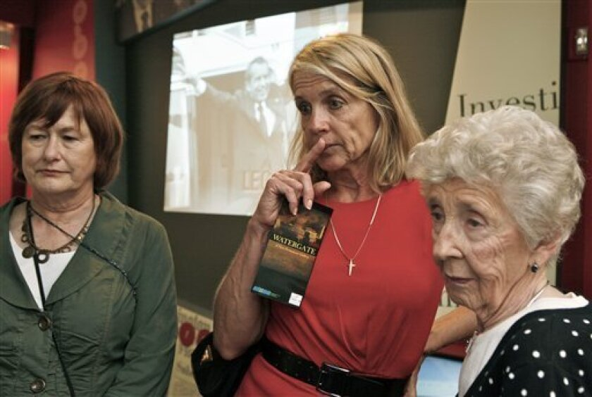 Visitors Colleen Green, left, Darlene Sky, middle, and Maggie Zwart tour The Watergate Gallery, a new exhibit on the history of the Watergate scandal leading to the resignation of former President Richard Nixon, at the Richard Nixon Presidential Library in Yorba Linda, Calif.,  Thursday, March 31,