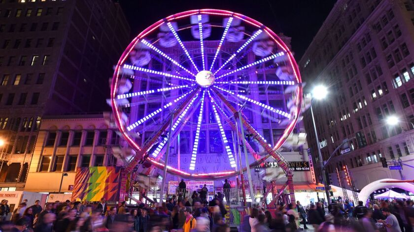 LOS ANGELES, CA - JANUARY 28, 2017: A ferris wheel spins at the Night on Broadway, a free arts and m