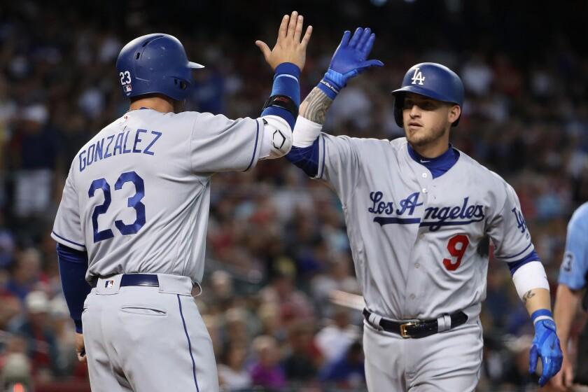 Dodgers catcher Yasmani Grandal (9) high fives Adrian Gonzalez (23) after Grandal hit a two-run hom