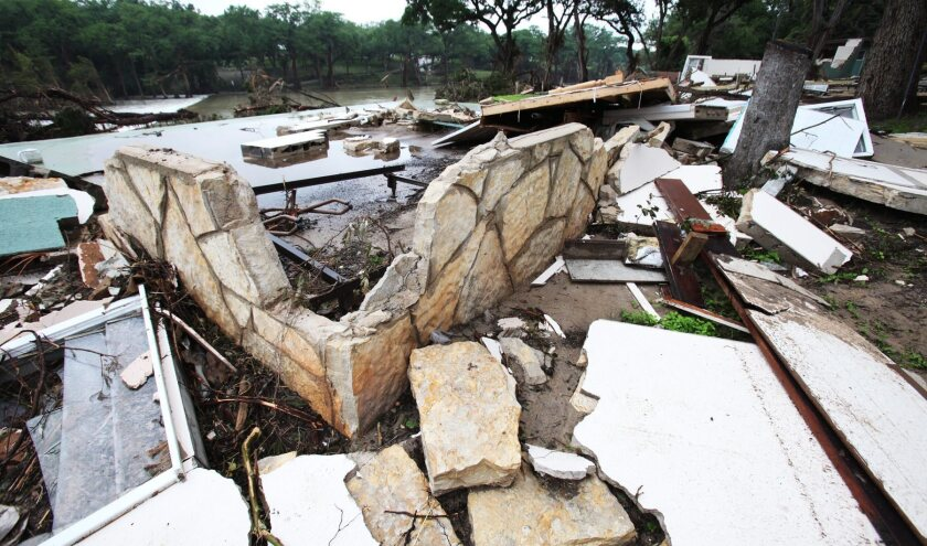 The overflowing Blanco River destroyed a structure on the bank in Wimberley, Texas.