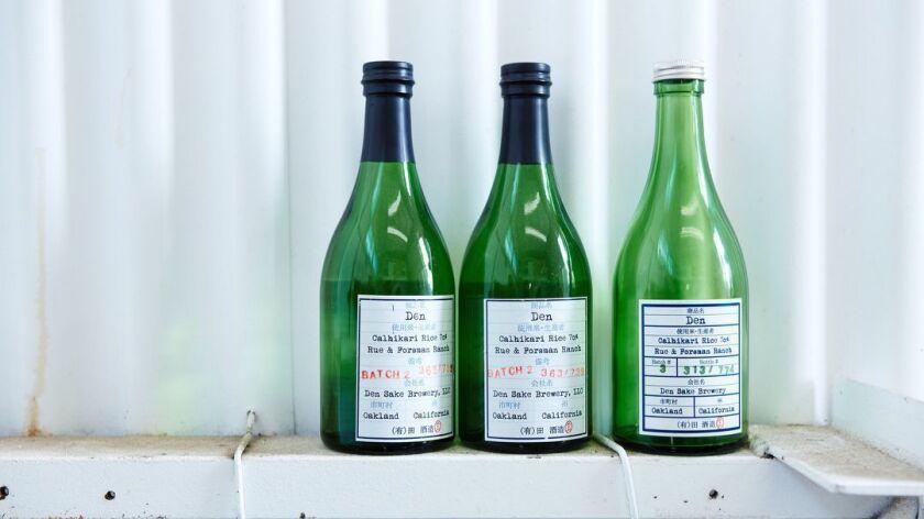 Oakland, CA - March 9, 2019: Bottles of Den Sake at the Den Sake Brewery.
