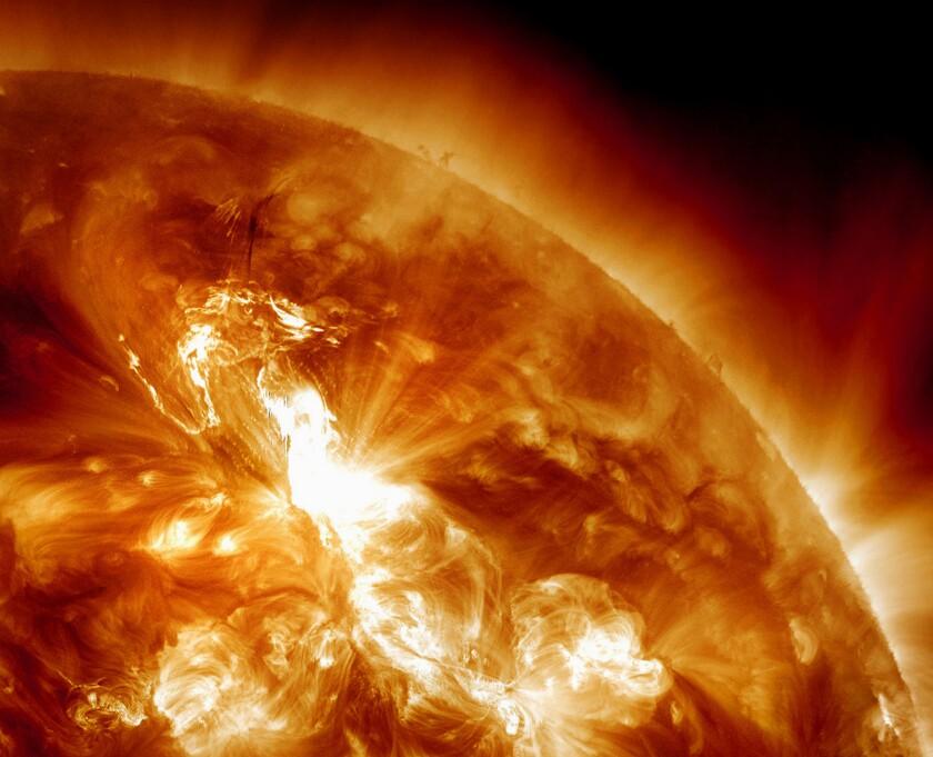 A flare erupts on the sun's northeastern hemisphere.