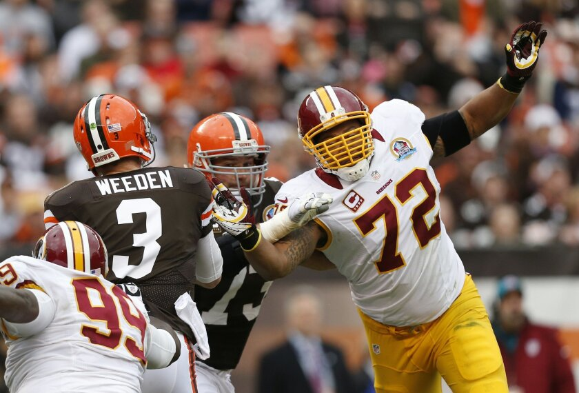 FILE - In this Dec. 16, 2012, file photo, Washington Redskins defensive end Stephen Bowen (72) tries to get a hand on Cleveland Browns quarterback Brandon Weeden (3) in the second quarter of an NFL football game in Cleveland. Bowen has retired after playing 10 NFL seasons with Dallas, Washington an