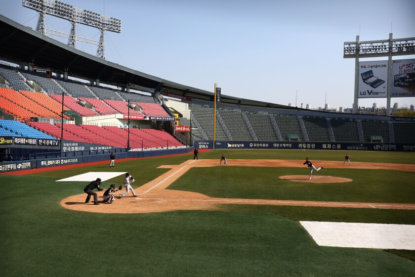 The LG Twins play an intrasquad game in an empty baseball stadium in Seoul on Sunday.