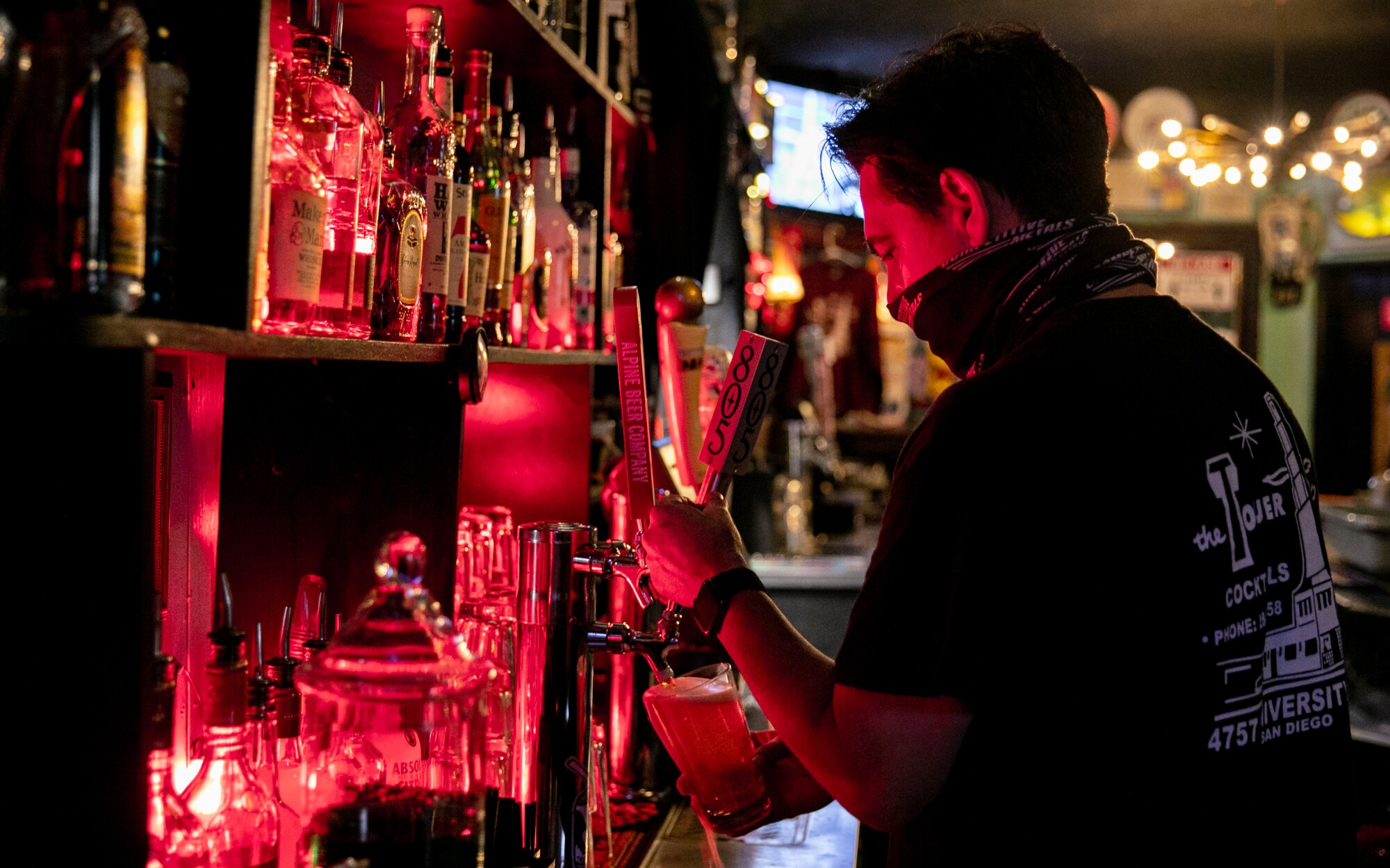 Mick Rosller, owner of The Tower Bar, works behind the bar