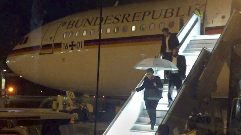German Chancellor Angela Merkel leaves the chancellor's Airbus in Cologne last year after making an emergency landing.