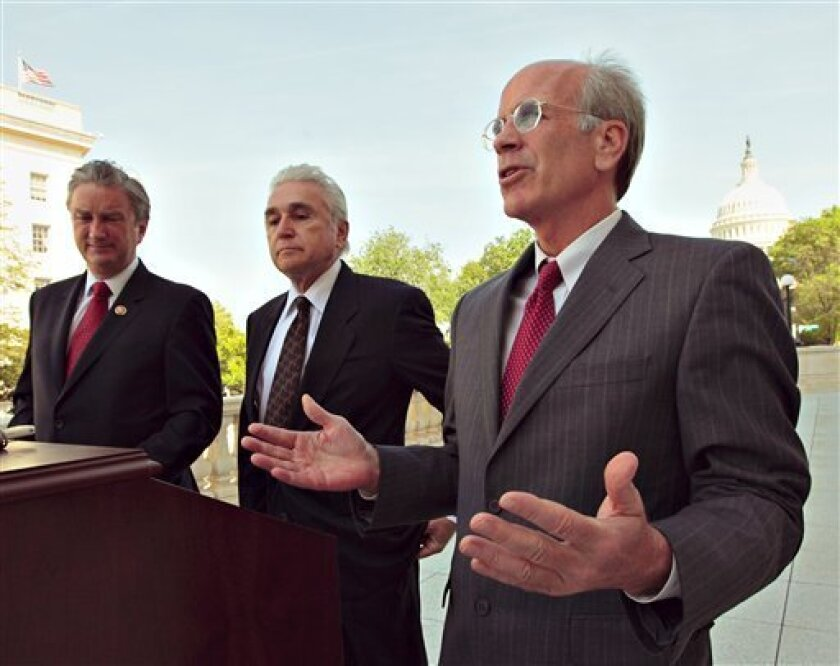 Rep. Peter Welch, D-Vt., right, Rep. Maurice Hinchey, D-N.Y., center, and Rep. John Tierney, D-Mass., left, discuss their amendment to the Credit Cardholder's Bill of Rights bill that would cap interest rates on all credit cards at 18 percent on Capitol Hill, Tuesday, April 28, 2009. (AP Photo/J. Scott Applewhite)