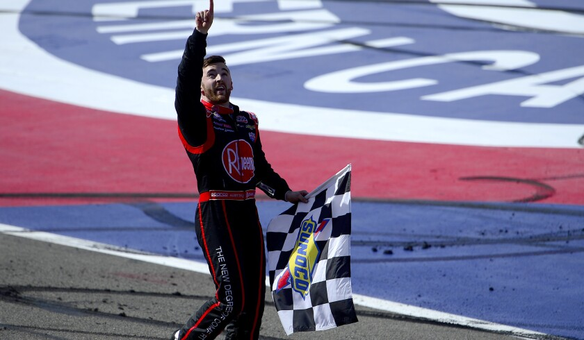 NASCAR driver Austin Dillon celebrates after winning the Xfinity Series TreatMyClot.com 300 on Saturday at Auto Club Speedway.