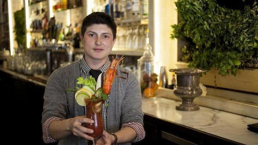 Bar manager of Cafe 21, Zane Mandt, makes one of their bloody meals called Prawn Star. (Jarnard Sutton)