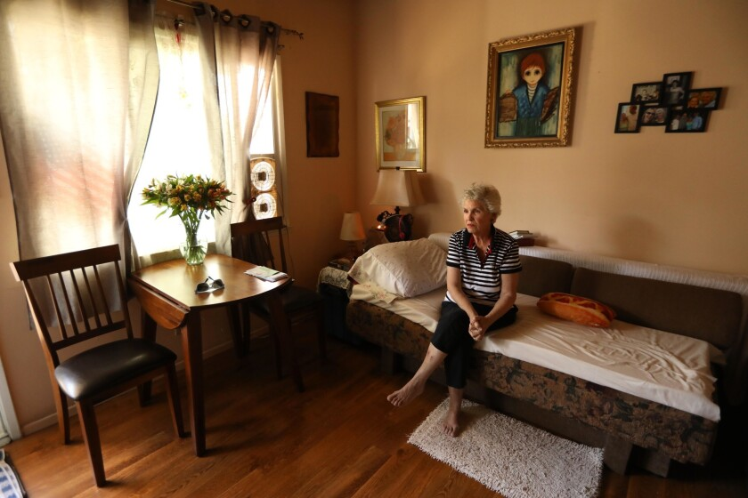 """""""I'm sad, I'm sad with the loss of neighbors,"""" said Carol Thompson, 75, seated in her apartment on N. Detroit Street in Hollywood on Sept. 26."""