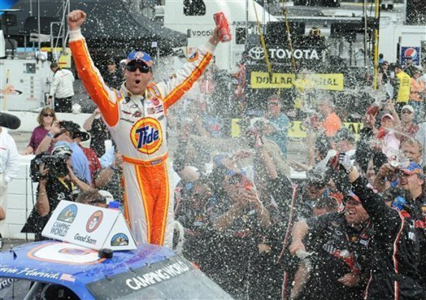 Kevin Harvick celebrates in victory lane after winning the NASCAR Truck Series auto race, Saturday March 31, 2012. in Martinsville, Va.  (AP Photo/Don Petersen)