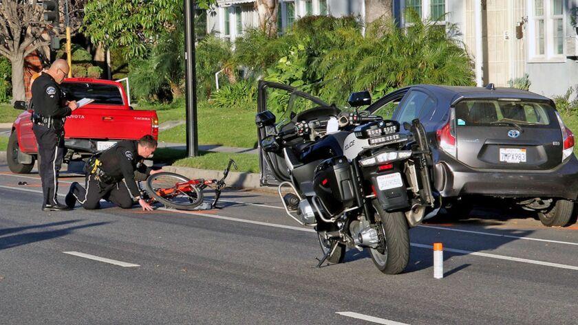 BPD Fatal Bike vs Parked Car 1604 Alameda St. (Photo by © Ross A Benson)