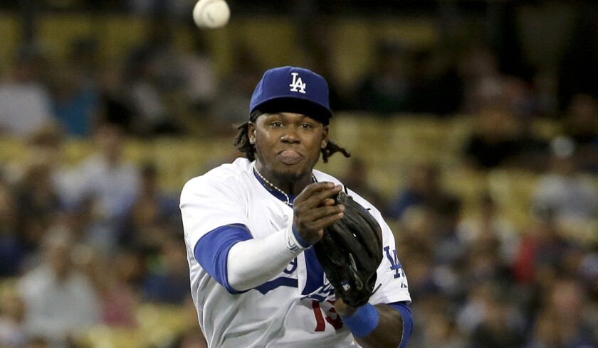 Dodgers shortstop Hanley Ramirez, making a throw to put out Colorado's Drew Stubbs in fourth inning, says his injured right ring finger did not affect his throw on an error in the seventh inning Wednesday night.