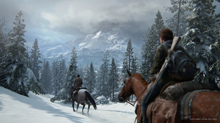 """Characters ride on horseback through snowy trees and mountains in """"The Last of Us Part 2."""""""