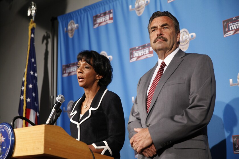 L.A. police Chief Charlie Beck at a 2014 news conference with Los Angeles County Dist. Atty. Jackie Lacey. Beck has asked Lacey to file charges against an LAPD officer who killed an unarmed man in Venice last year.