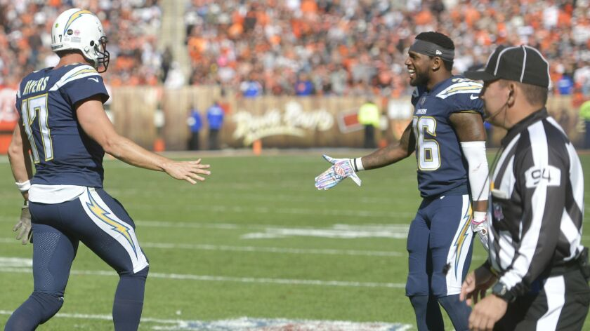 Down judge Hugo Cruz (right) was fired by the NFL after missing a call in the Chargers win' over the Browns earlier this season. The Chargers scored a touchdown on the play which should not have counted because of a missed false start penalty.