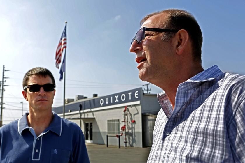 Steve Dayan, right, secretary-treasure of Teamsters local 399 talks as Adam Roodman , left, vice president of Quixote, listens as Teamsters local 399 talk outside Quixote Studios on Penrose in Los Angeles.