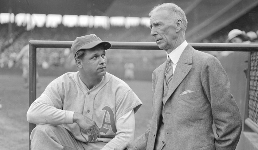 Slugger Jimmie Foxx speaks with Connie Mack, his manager on the Philadelphia Athletics.