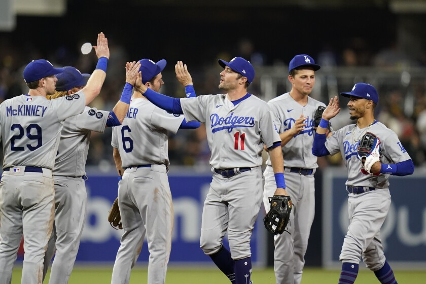 Dodgers left fielder AJ Pollock celebrates with teammates after the Dodgers defeated the San Diego Padres.