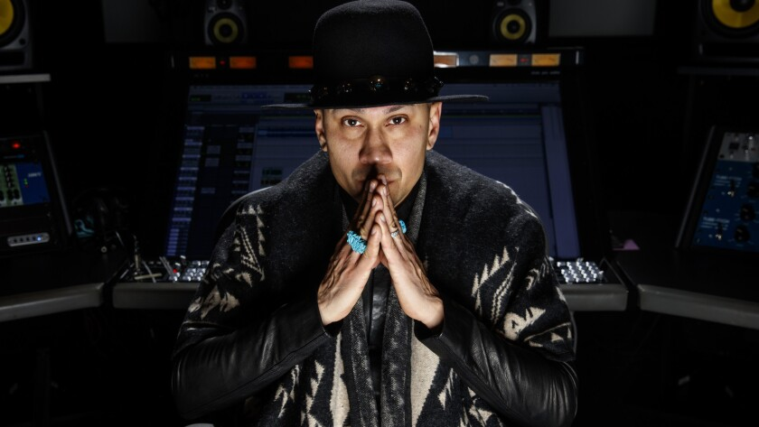 """Jimmy """"Taboo"""" Gomez of the Black Eyed Peas is photographed at will.i.am's recording studio in Los Angeles"""