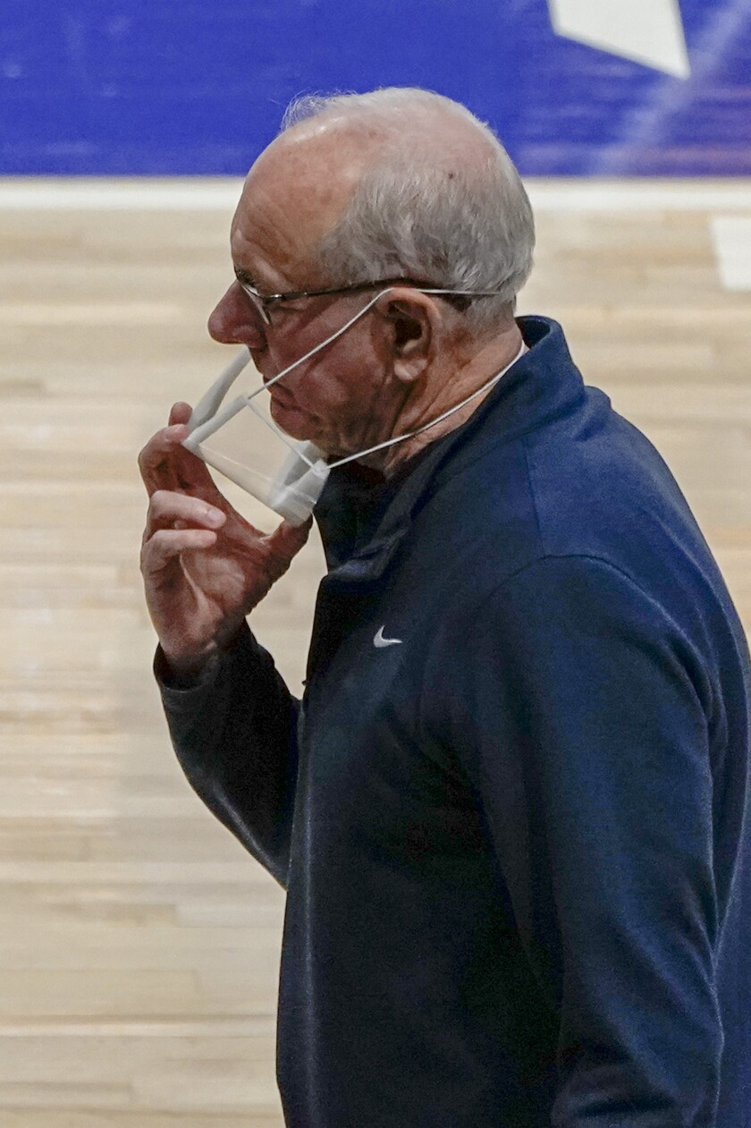Syracuse head coach Jim Boeheim adjusts his mask as his team plays against Pittsburgh during the first half of an NCAA college basketball game, Saturday, Jan. 16, 2021, in Pittsburgh. Pittsburgh won 96-76. (AP Photo/Keith Srakocic)