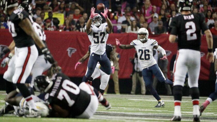 Chargers linebacker Denzel Perryman intercepts a pass from Falcons quarterback Matt Ryan during a ga
