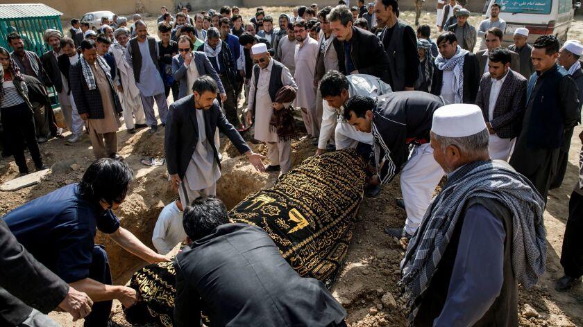 KABUL, KABUL PROVINCE -- FRIDAY, OCTOBER 20, 2017: Mourners bury 83-year-old Karbalai Mohammad Anwa