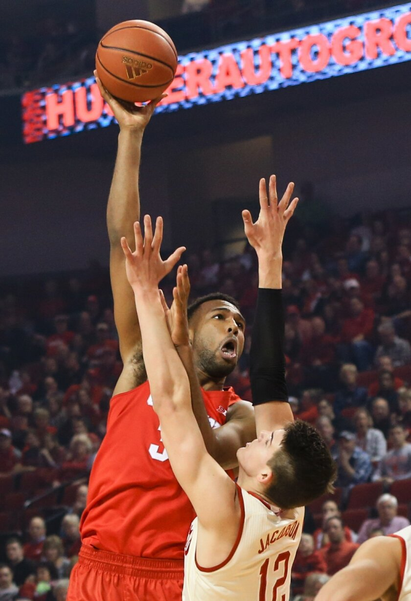 Ohio State's Trevor Thompson (32) shoots over Nebraska's Michael Jacobson (12) during the first half of an NCAA college basketball game in Lincoln, Neb., Saturday, Feb. 20, 2016. (AP Photo/Nati Harnik)