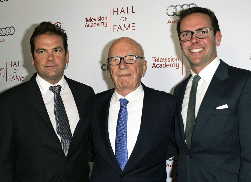 21st Century Fox Executive Chairman Rupert Murdoch, center, and his sons, Lachlan, left, and James Murdoch at the 2014 Television Academy Hall of Fame in Beverly Hills.