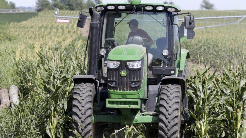 The Trump administration announced Tuesday it will provide $12 billion in emergency relief to ease the pain of American farmers slammed by President Donald Trump's escalating trade disputes.