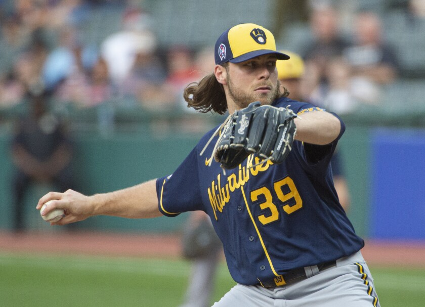 Milwaukee Brewers starting pitcher Corbin Burnes delivers against the Cleveland Indians.