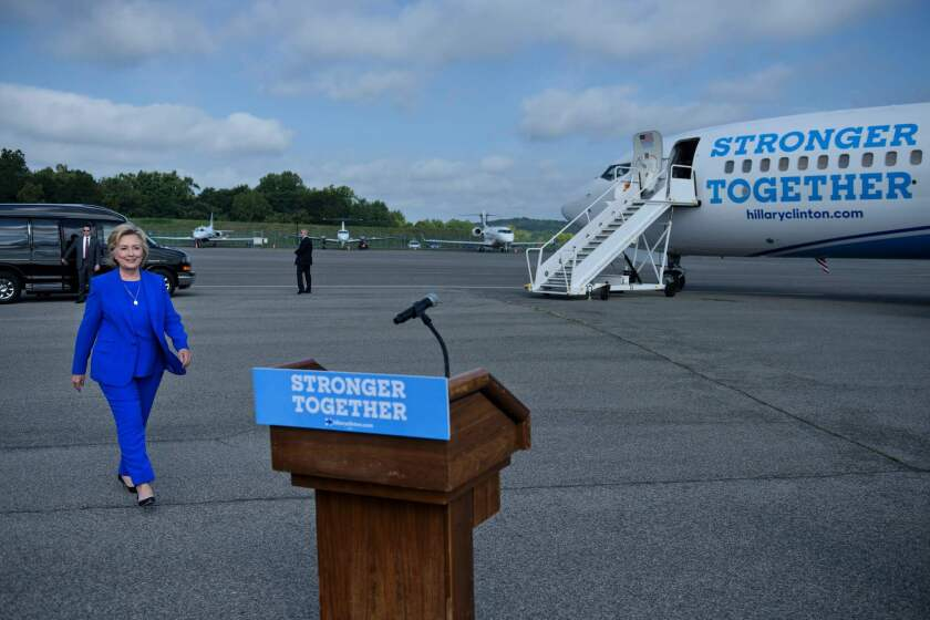 Hillary Clinton walks to speak to reporters on the tarmac at Westchester County Airport on Thursday in White Plains, N.Y.