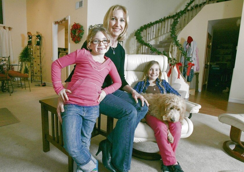 The Krumweide family — including Hanna (left), 7, Chloe, 9, and their mother, Molly — bought a house in University City 10 years ago and have seen it appreciate significantly.