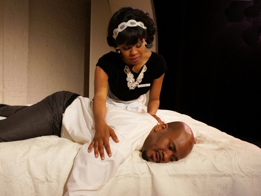 "A motel maid (Danielle Truitt) provides unexpected solace and guidance to the Rev. Martin Luther King Jr. (Larry Bates) in ""The Mountaintop"" at the Matrix Theatre."