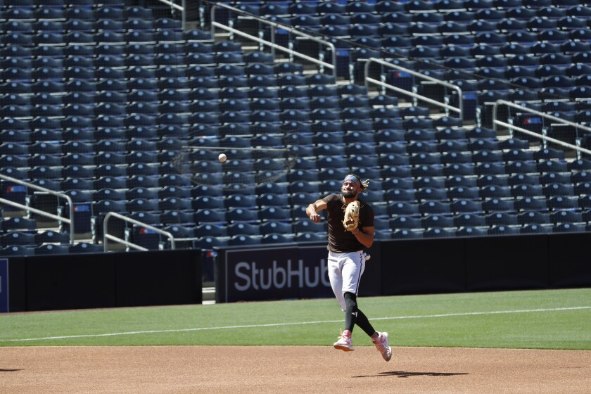 Padres shortstop Fernando Tatis Jr. makes a play during a practice Wednesday at Petco Park.