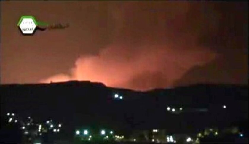 In this image taken from video obtained from the Ugarit News, which has been authenticated based on its contents and other AP reporting, smoke and fire fill the the skyline over Damascus, Syria, early Sunday, May 5, 2013 after an Israeli airstrike. Israeli warplanes struck areas in and around the Syrian capital Sunday, setting off a series of explosions as they targeted a shipment of highly accurate, Iranian-made guided missiles believed to be on their way to Lebanon's Hezbollah militant group,