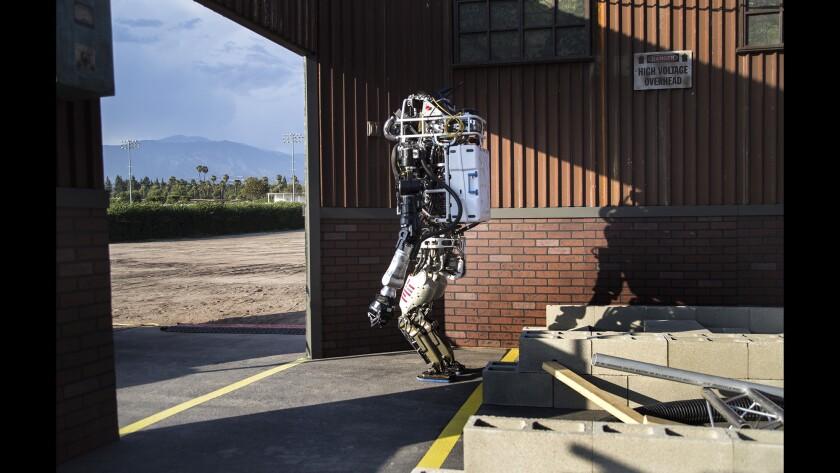 Robot walks through a door.