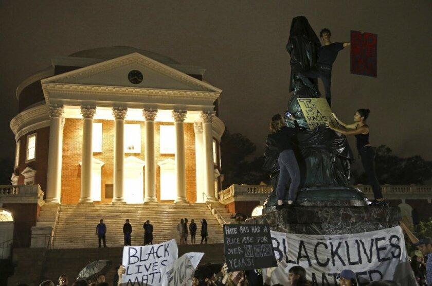 Protesters cover Thomas Jefferson statue in black  Was Trump