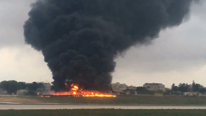 Smoke billows after a light plane crashed after takeoff from Malta airport, in Valletta, on Oct. 24, 2016.