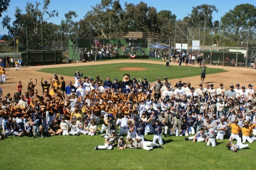 All of the La Jolla Youth Baseball teams pose for a photo with their different San Diego Padres uniforms Saturday during Opening Day. Courtesy photos