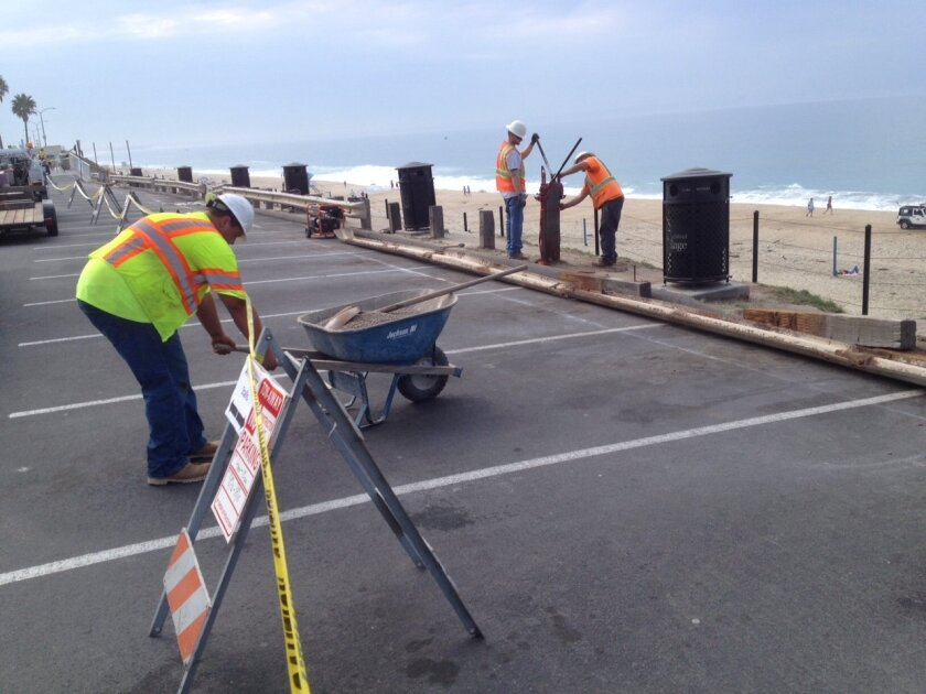 The popular Ocean Street parking lot north of Carlsbad's downtown seawall is closed this week, part of a series of coastal access improvements in the city.